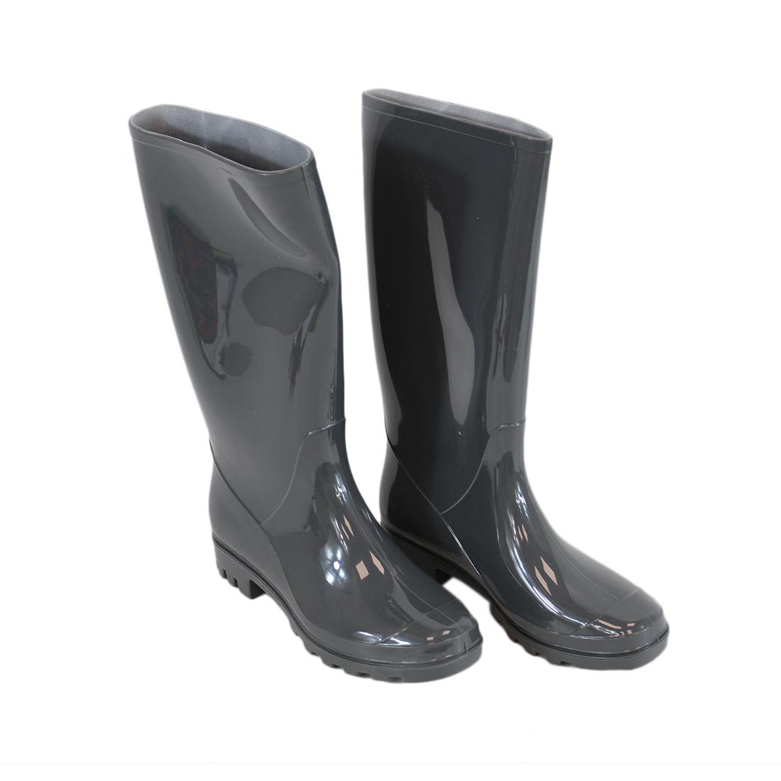 Tall glossy wellington boots